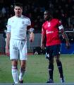 Mavuba face à Gerrard.png