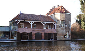 Han van Meegeren - Han van Meegeren designed this boathouse (the building left, adjoining an old tower in the town wall) for his Rowing Club D.D.S. while studying architecture in Delft from 1907 to 1913.
