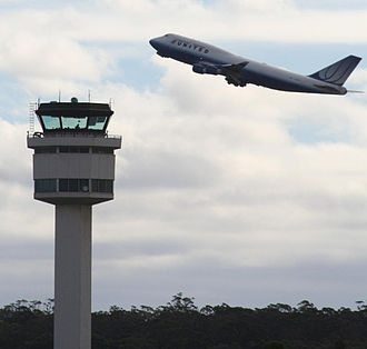 Transport Integration Act 2010 - Shot of the airport control tower and a United B747 at Melbourne Airport.  Transport to and from the airport is currently only available by car or bus. The absence of an integrated rail link has been a matter of public debate in Victoria in recent years.