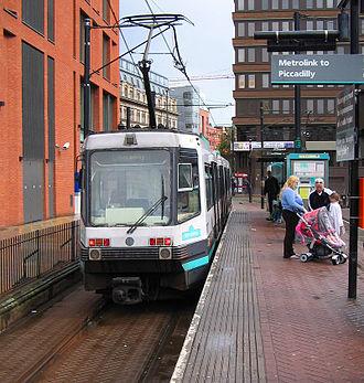 Piccadilly Gardens tram stop - Image: Metrolink tram at Piccadilly Gardens