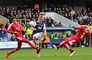 Steve Morison - Morison (wearing blue) playing against Swindon Town in 2015, during his third spell at Millwall