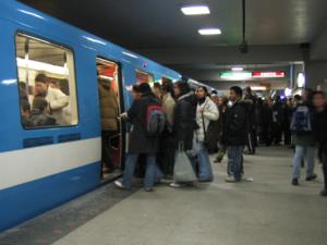 A train at Berri-UQAM during rush hour