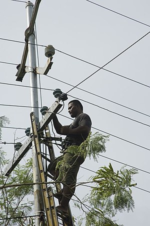 Overhead power line - A man working on powerlines in Nauru (2007)
