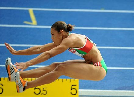 Naide Gomes in the jumping phase of the event - Track and field