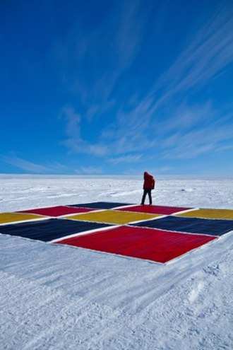 Nasser Azam - Azam preparing his canvases on an ice desert in Antarctica.