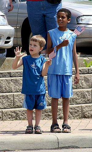 Racial integration -  A white child and black child together at a parade in North College Hill, Ohio, USA