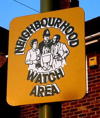 Neighbourhood Watch (United Kingdom) - A British Neighbourhood Watch sign affixed to a lamppost.