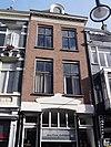 foto van Gepleisterd dwarshuis met verdieping en zadeldak