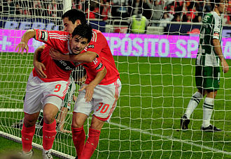 Goal celebration - Nolito celebrates scoring a goal by running from teammates.