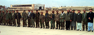 Northern Alliance - United Front troops lined up next to the runway at Bagram Airfield in Parwan Province. (December 16, 2001)