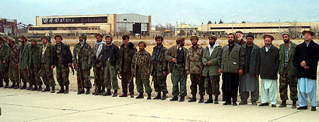 Northern Alliance troops line a runway at Bagram Airbase.