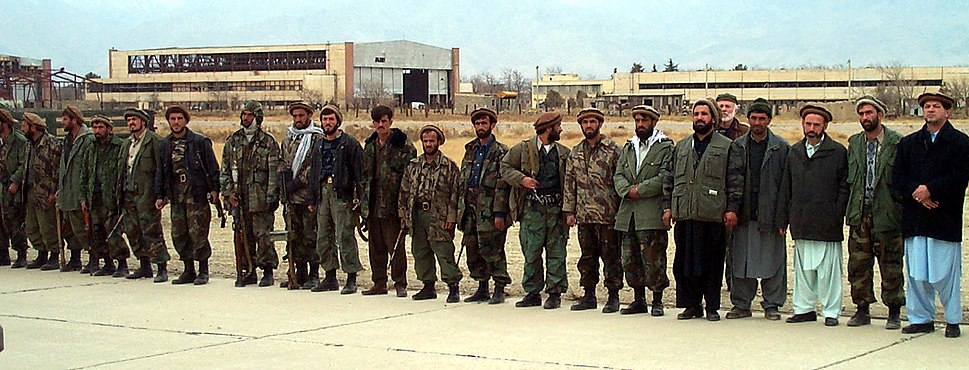 Northern Alliance troops line a runway at Bagram Airbase