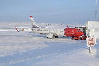 Rovaniemi Airport - A Norwegian Air Shuttle 737-8JP aircraft at a snowy Rovaniemi Airport