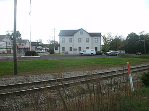 Oakland, New Jersey - The patch of grass representing the former Oakland Station, which was demolished in 1999, as viewed in October 2011