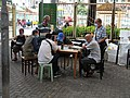 Old early is playing Chinese chess in the street at Yuen Long.jpg