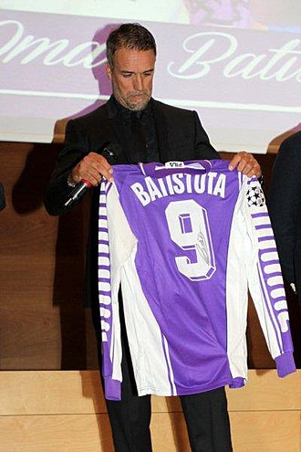 Forward (association football) - Gabriel Batistuta holding his old number 9 Fiorentina jersey. The number most associated with the position, he was an out and out striker