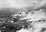 Operation OYSTER - Douglas Bostons fly over the burning Emmasingel lamp and valve factory at the height of the raid.jpg
