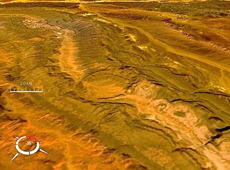 Ouarkziz crater - Oblique Landsat image of Ouarkziz crater draped over digital elevation model (x2 vertical exaggeration); screen capture from NASA World Wind