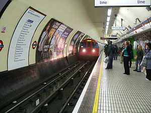 Oxford Circus tube station - A Bakerloo line train arrives at the northbound platform, looking south.
