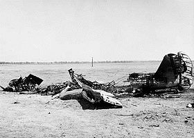 An aircraft's burnt-out wings, fuselage and tail fin