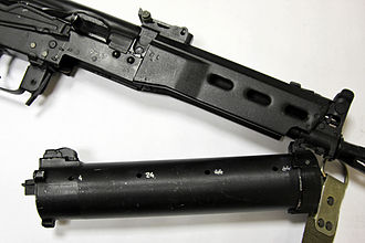 PP-19 Bizon - The Bizon SMG with detached magazine. Demonstrated is the hinge-like action required to seat the magazine.