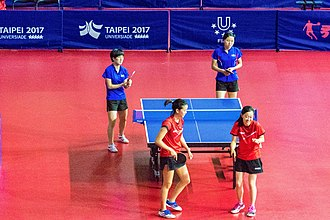 A 2017 match between players from the United States and North Korea. PRK USA women's doubles Universiade2017 2.jpg