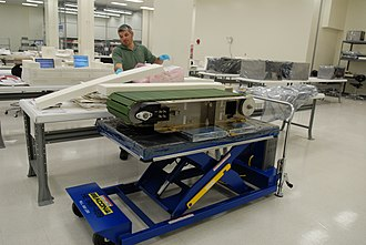 Treadmill with Vibration Isolation Stabilization - Pete Gauthier, a packing engineer for United Space Alliance, prepares the COLBERT and its parts for loading into the Multi-Purpose Logistics Module ''Leonardo'' in preparation for launch to the International Space Station.