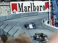 Patrick Depailler - Tyrrell P34 follows Mario Andretti - Lotus 78 out of Tabac at the 1977 Monaco GP.jpg