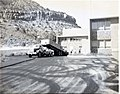 Paving of employee parking area, Mission 66 Visitor Center and Museum. Truck pouring hot mix at loading dock area. ; ZION Museum (b420dc9ab59b4fd7983a49e5a0654423).jpg
