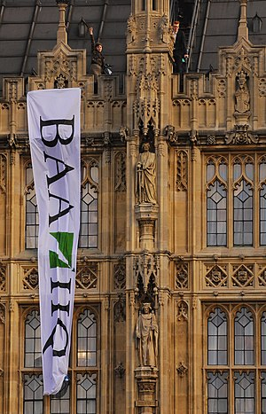Expansion of Heathrow Airport - Plane Stupid activists on the roof of the Palace of Westminster in 2008 complaining about BAA's close links with government