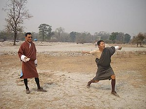 Sports in Bhutan - Bhutanese men playing digor.