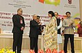 """Pranab Mukherjee presenting the Swarna Kamal Award for Best Direction """"Aaranyak in Non Feature Films Section to the Director, Ms. Renu Savant, at the 62nd National Film Awards Function.jpg"""