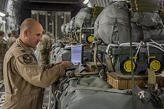 Joint Precision Airdrop System - An officer programs a JPADS bundle with drop coordinates in preparation for a resupply mission