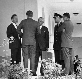 Blockade - President Kennedy and his advisors discuss the Cuban Missile Crisis. Part of the US response to Soviet missiles being placed in Cuba was a naval blockade of the island.