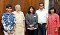 Prime Minister Narendra Modi with open water swimmer Bhakti Sharma.jpg
