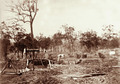 Queensland State Archives 2481 Small diggings with windlass Lucky Valley Goldmine c 1898.png