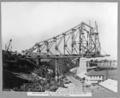 Queensland State Archives 3637 Main bridge erection 4 tower traveller on cantilever arm completing second panel Brisbane 2 June 1938.png