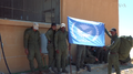Raqqa internal security forces with their flag.png