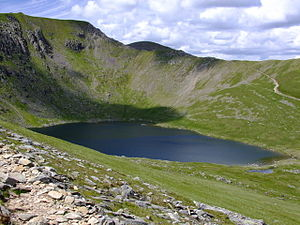 Helvellyn - The eastern side of Helvellyn: Looking down onto Red Tarn from Striding Edge, with the summit of Helvellyn and Swirral Edge beyond