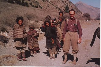 Rene de Milleville with Tibetan refugees in Gandaki Valley, near Jomosom, Nepal, October 1966. Note the head straps for carrying heavy loads. Most Tibetan refugees pass through Nepal to India, where The 14th Dalai Lama resides. Rene de Milleville 2.jpg