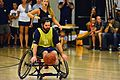 Retired U.S. Navy Explosive Ordnance Disposal Technician 1st Class John Kremer dribbles the ball down the court during a wheelchair basketball game against the Air Force team during the Wounded Warrior Pacific 140109-N-HA927-010.jpg
