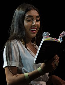 Rupi Kaur reading from her book milk and honey in Vancouver in 2017