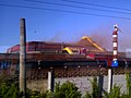 Rusty smoke above building of Izhorskiye Zavody 2011.jpg