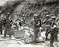 SC 269220 US 182nd Infantry soldiers searching linen found in cave Babag Ridge Cebu April 1945.jpg