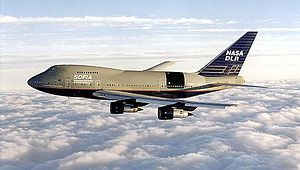 Stratospheric Observatory for Infrared Astronomy - The SOFIA aircraft pictured during a test flight in 1998. Still mostly in United Airlines livery, a black square has been painted on the aft fuselage to indicate the location of the door that will be opened in flight to allow the telescope access to the sky.