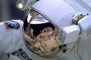 Bioastronautics - Image: STS 103 Reflection on astronaut's visor