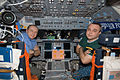 STS-130 Oleg Kotov and Maxim Suraev on Endeavour's flight deck.jpg