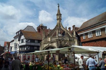 The 15th-century Poultry Cross originally marked the section of the market trading in poultry SalisburyMarket20040724 CopyrightKaihsuTai.jpg