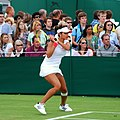 Sania Mirza during her first round match with Virginie Razzano, Day 2 of Wimbledon 2011.jpg