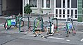 Scooters on a bicycle rack, Vienna.jpg